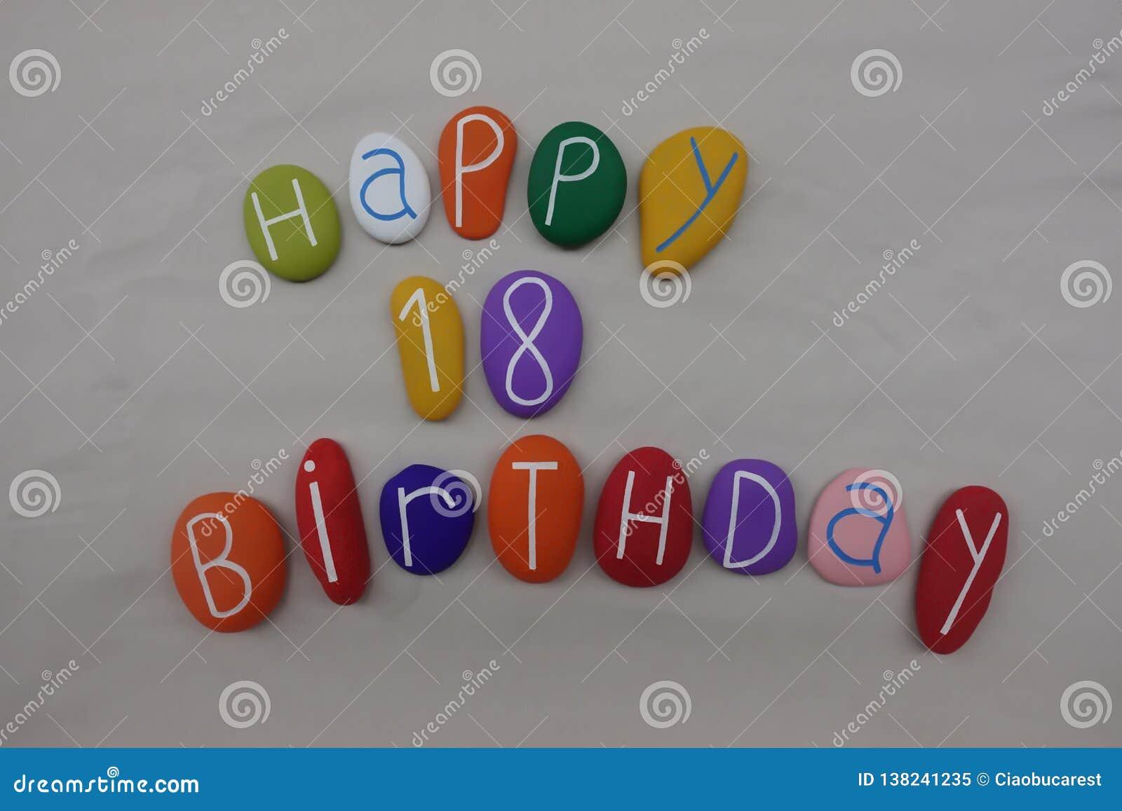 Feliz cumpleaños por 18 años en piedras coloreadas