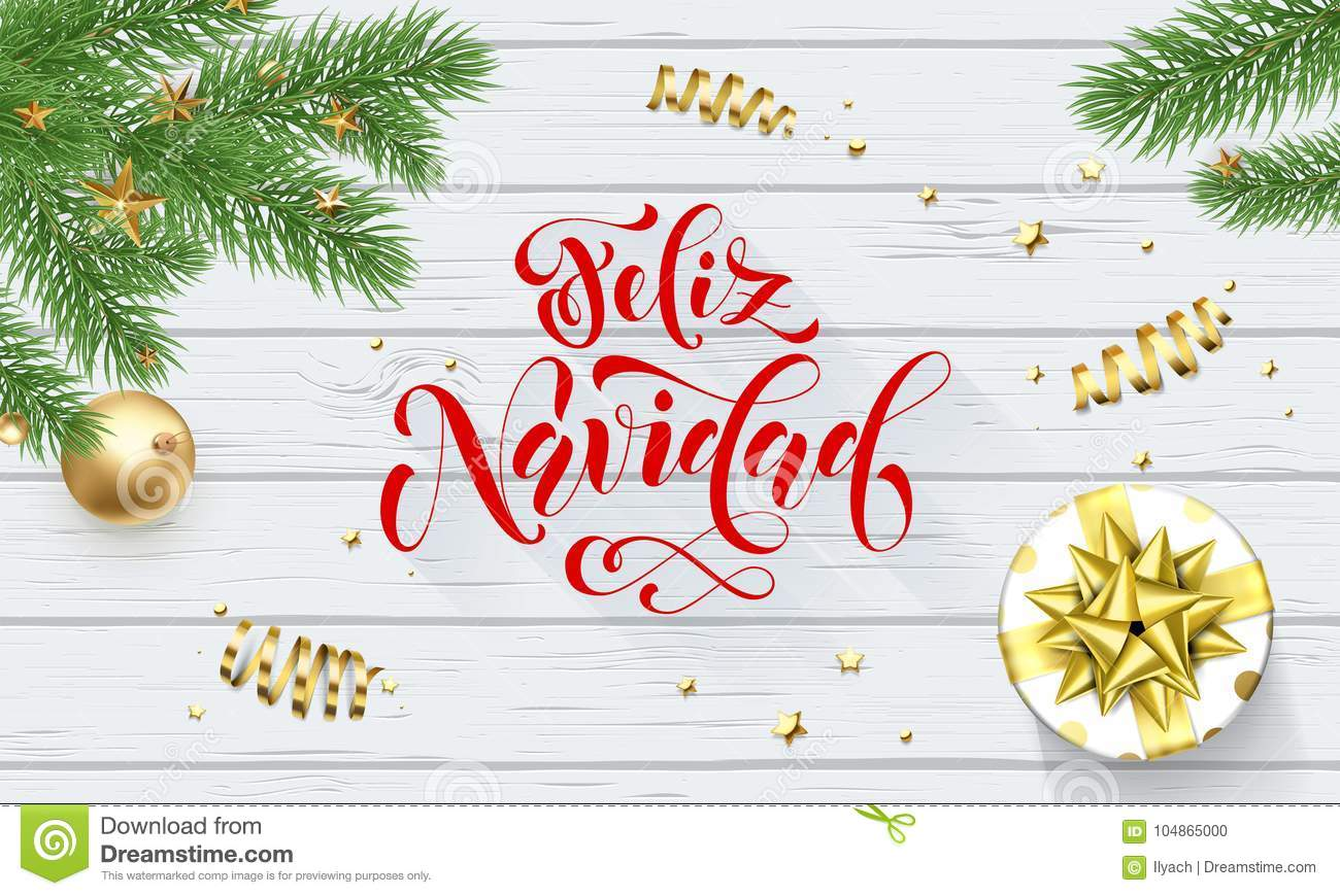 Feliz Navidad Spanish Merry Christmas holiday golden decoration on Xmas tree, calligraphy font for greeting card white wooden back