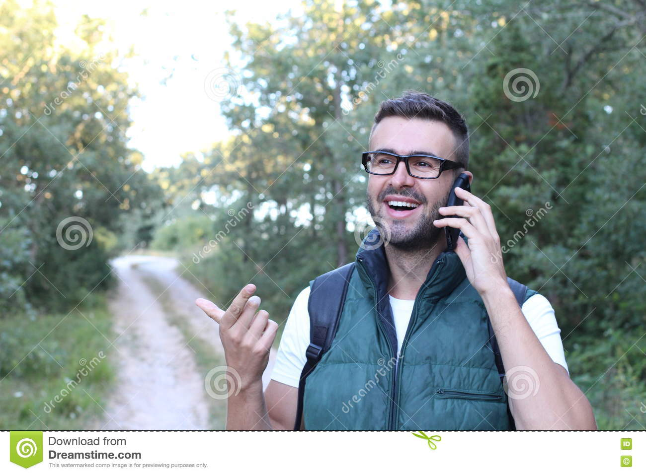 Fellow tourist calling by phone phone in the forest