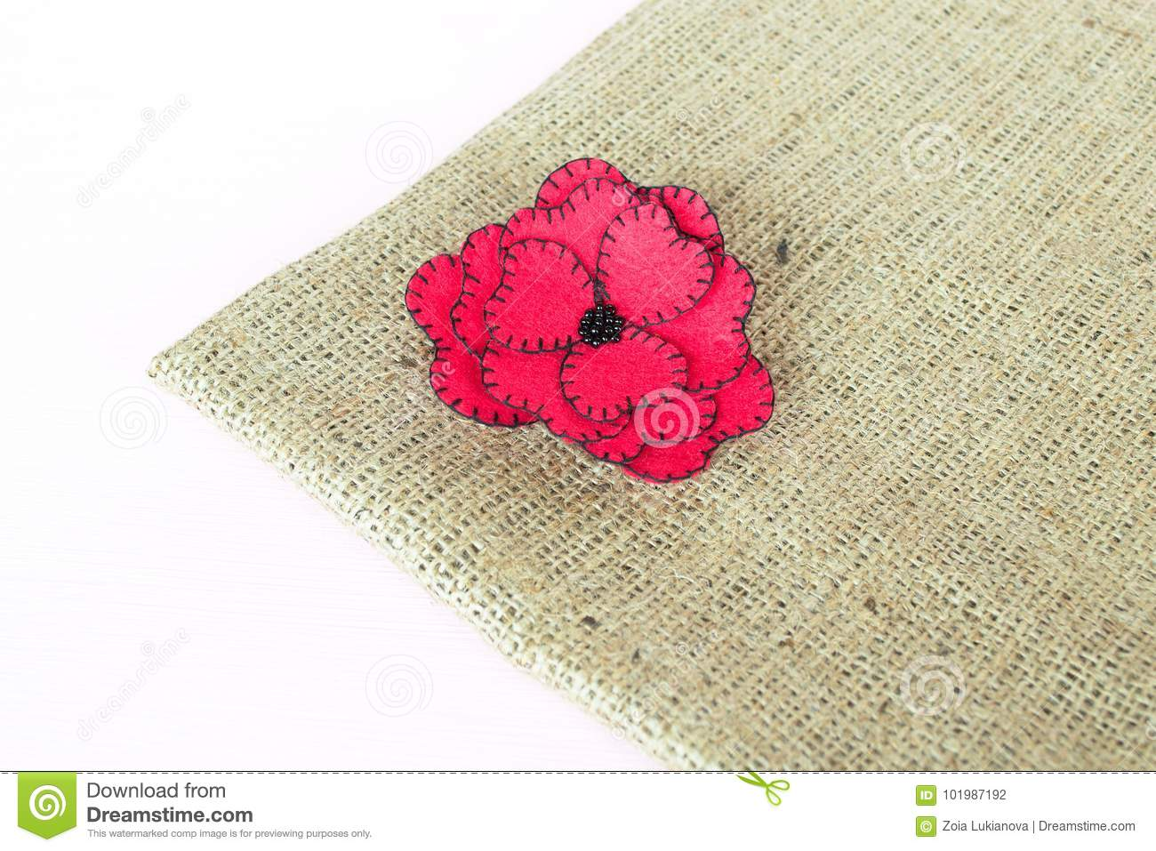 Red Felt Flower On Burlap And White Wooden Background Stock Photo