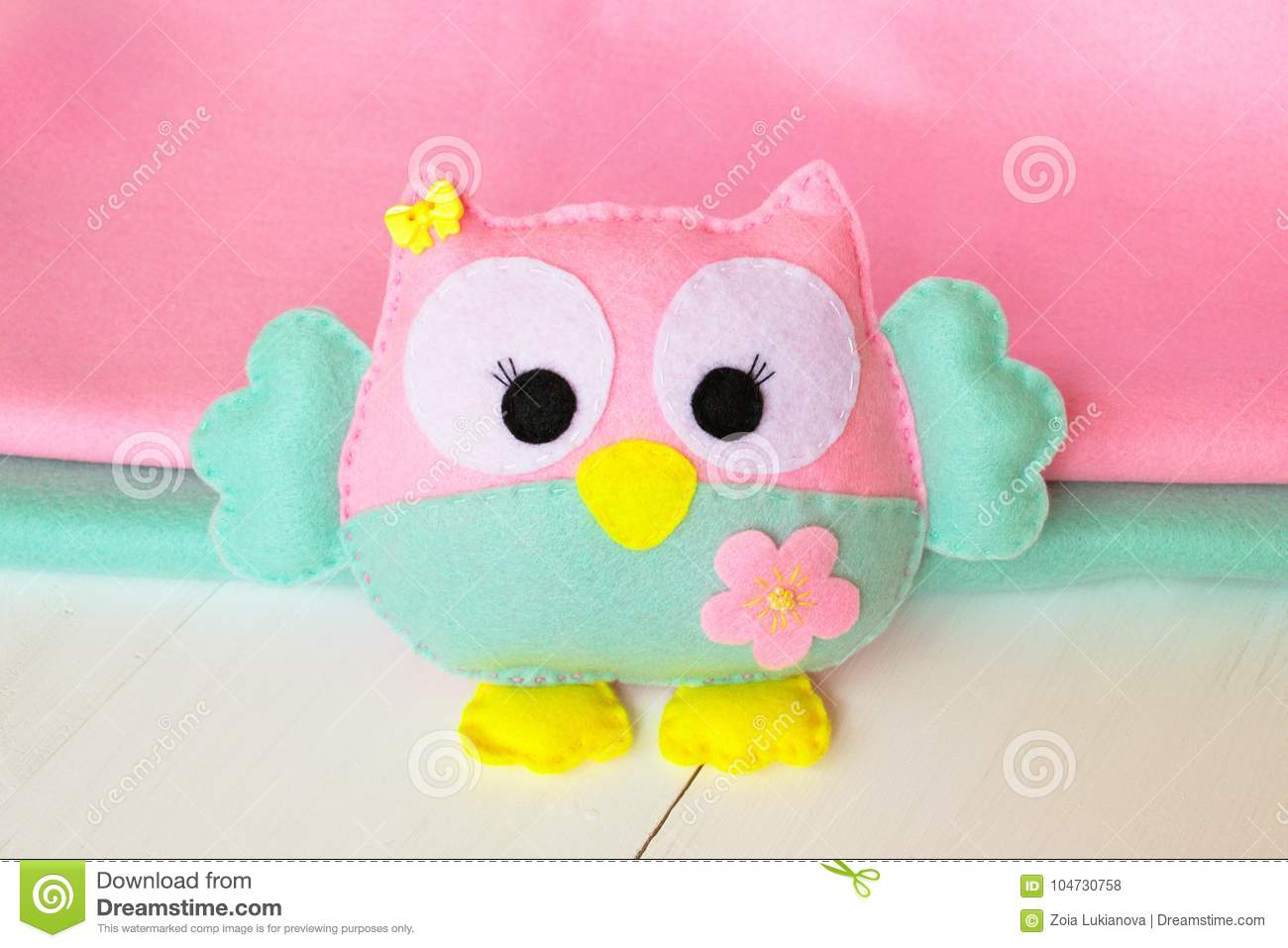 Felt Owl On A White Wooden Background Rolls Of Pink And Blue Felt