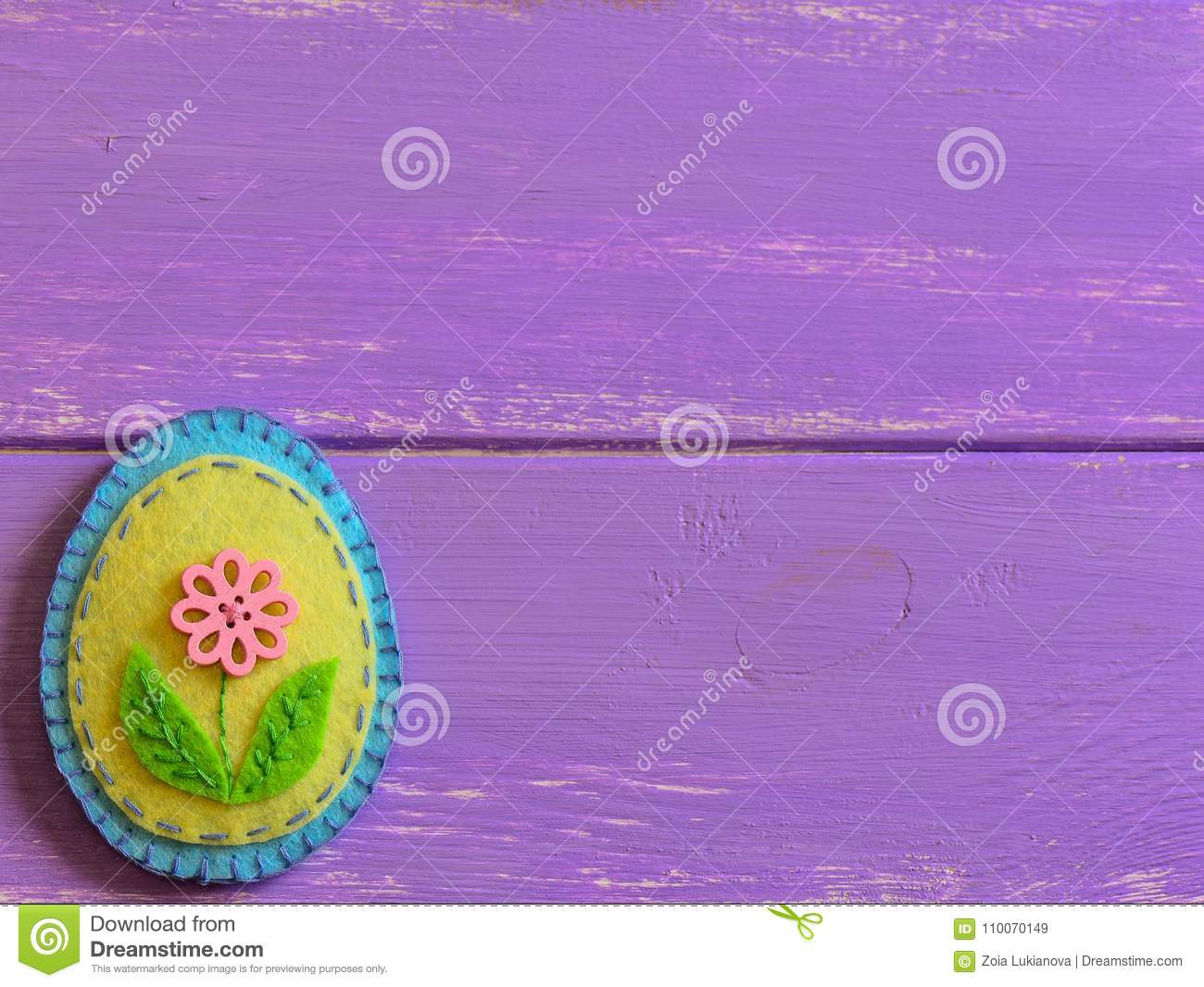 Felt Easter Egg Decor With Pink Flower On A Wooden Background With