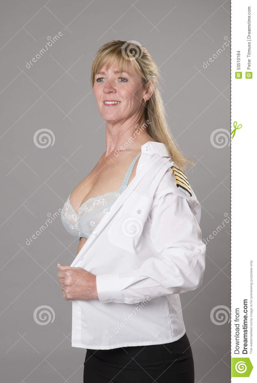 female airline officer getting dressed stock photo image