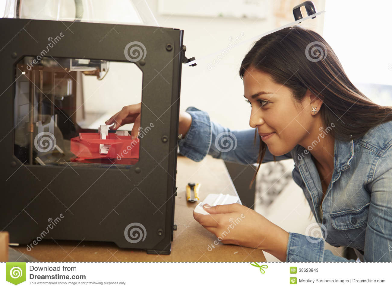Female architect using 3d printer in office stock photos Making models for 3d printing