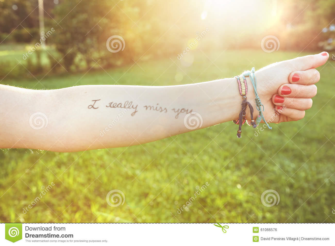 Female Arm With Text I Really Miss You Written Stock Photo Image