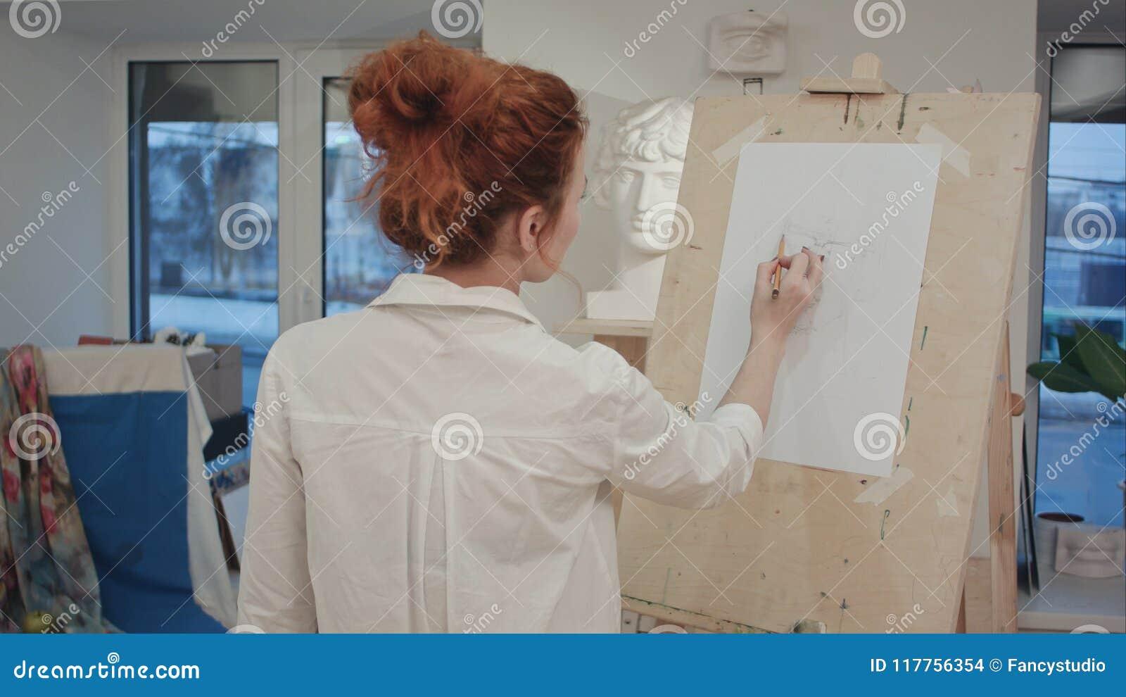 Female Art Student Drawing Plaster Cast On Easel Stock Photo