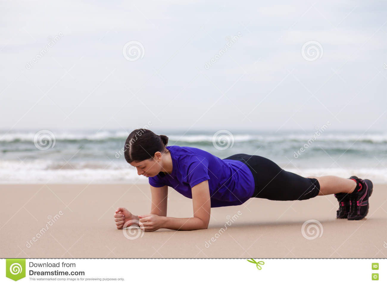 Female athlete executing the plank exercise