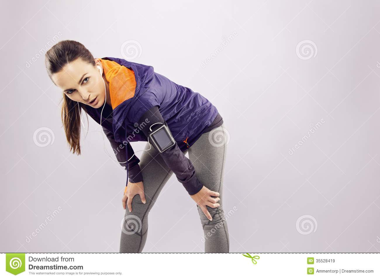 female athlete looking tired after a run royalty free
