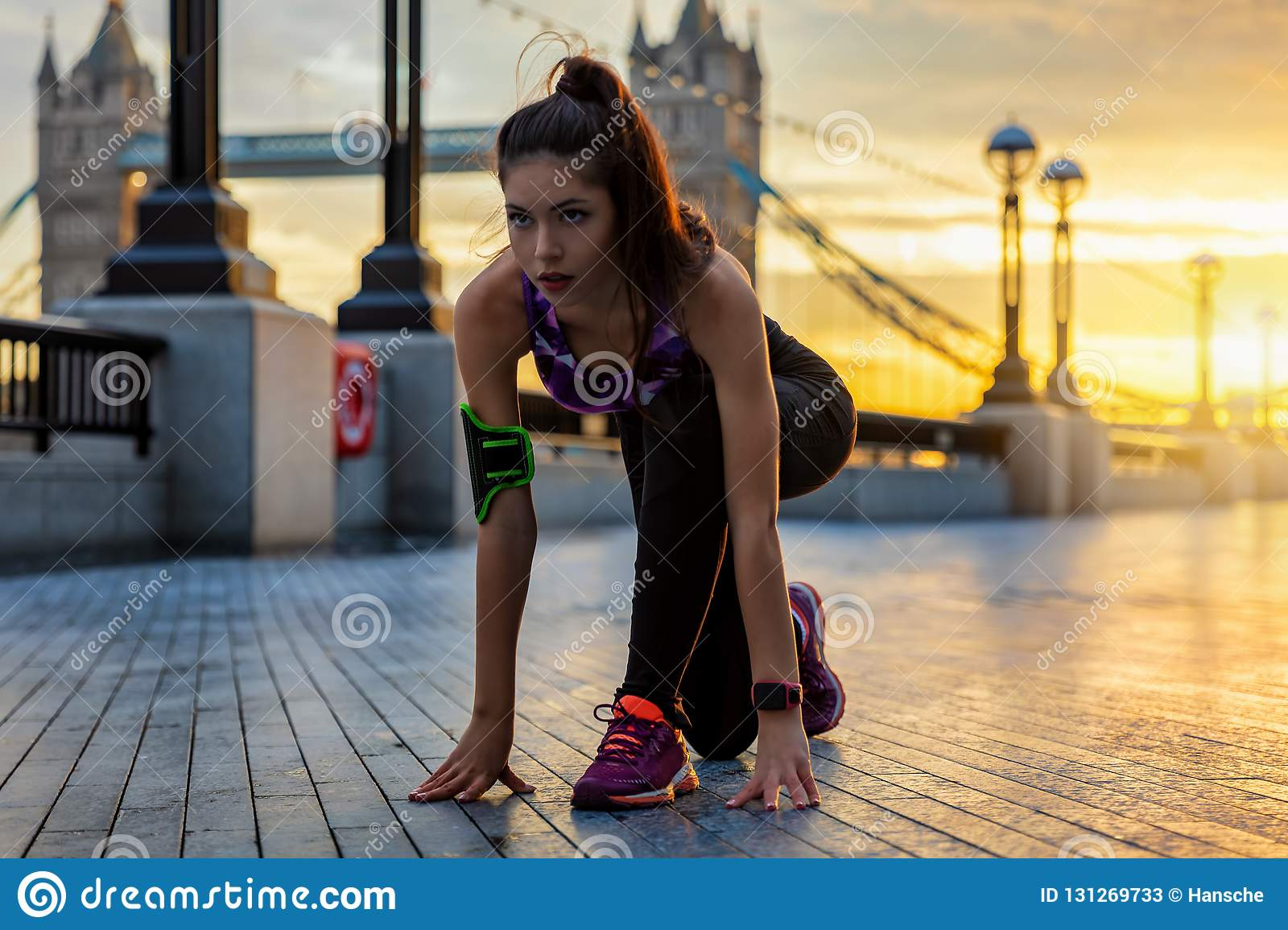 Female athlete ready to do her workout in an urban city