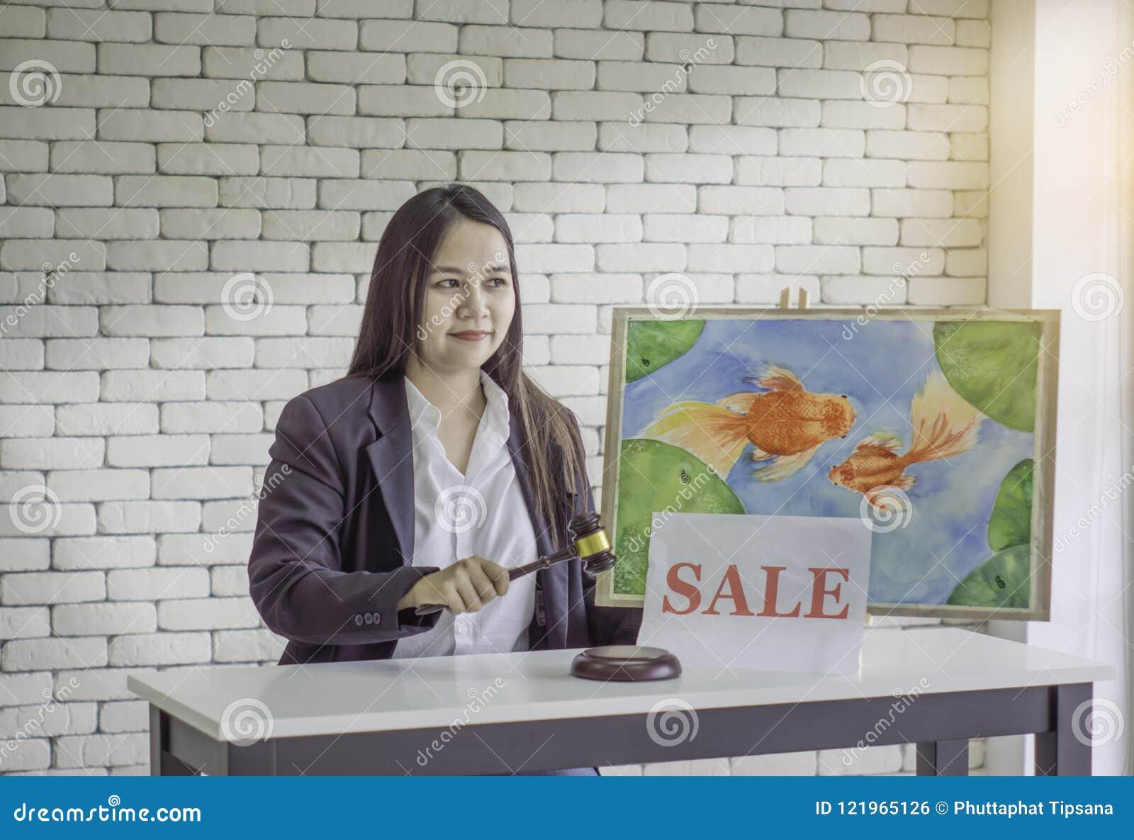 Female Auction Control, Hammer Knock to Goldfish Photo Auction, White Brick Background