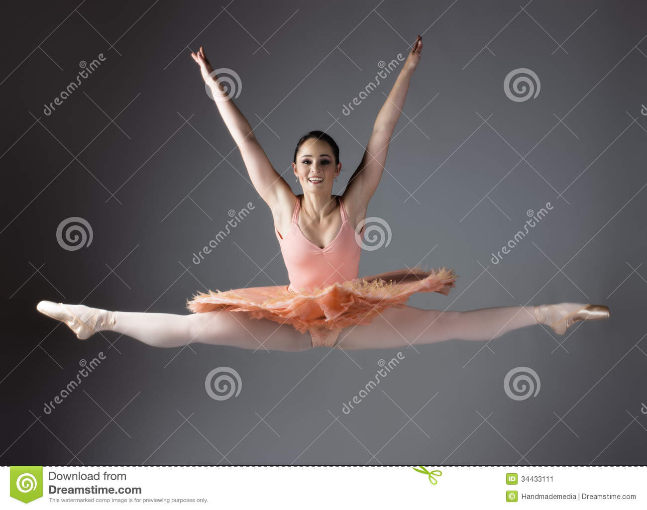 Beautiful female ballet dancer on a grey background ballerina is