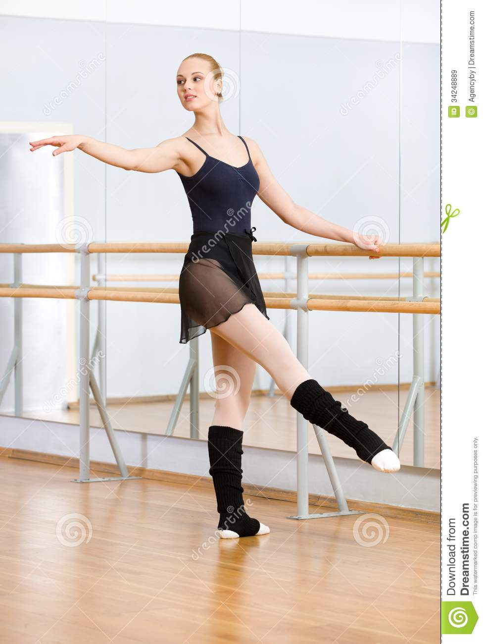 Female Ballet Dancer Dancing Near Barre In Studio Royalty