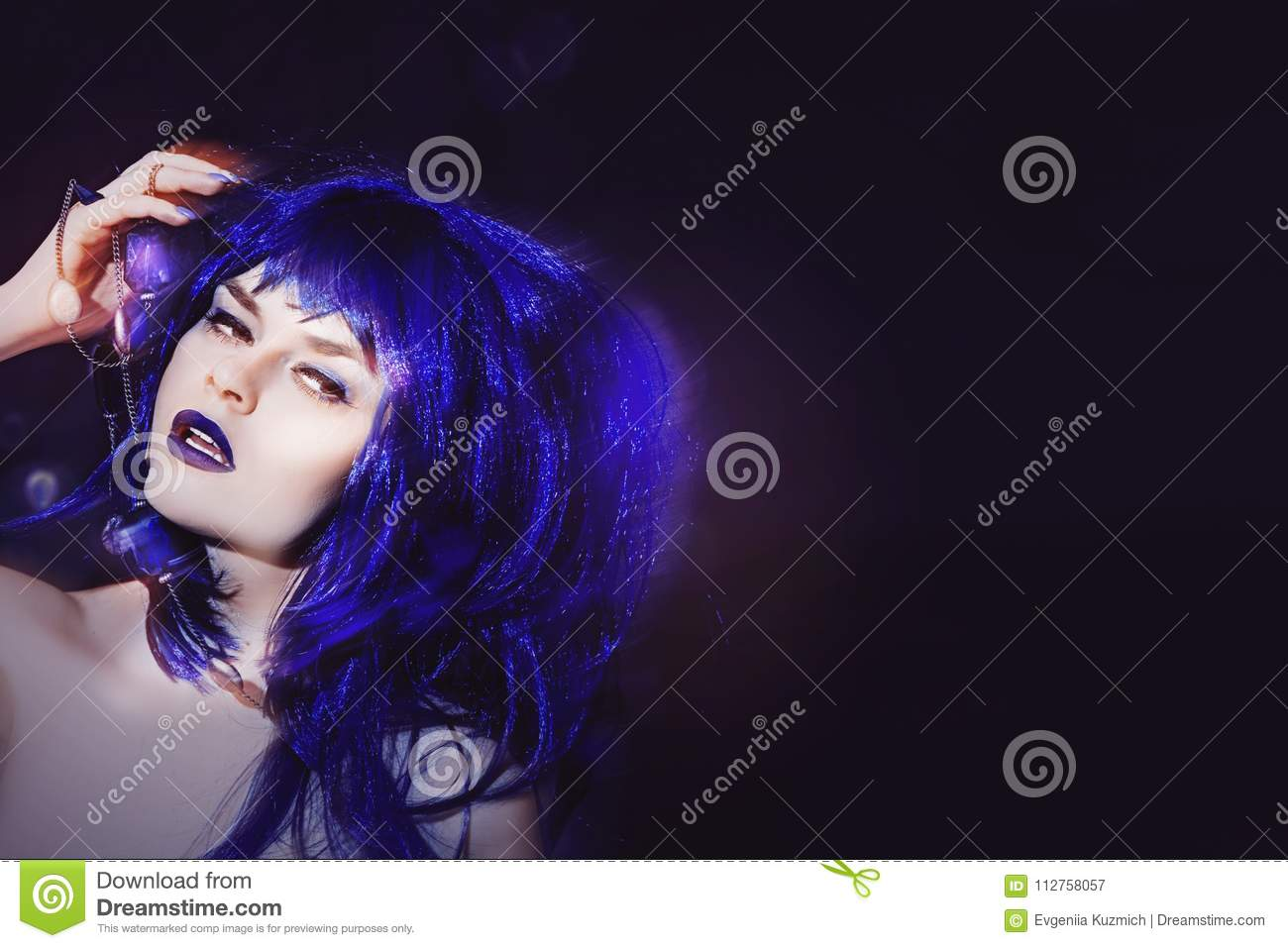 Female beautiful young model with hair the color purple, makeup