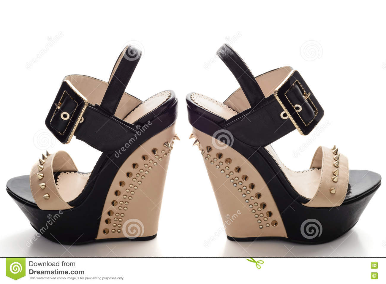 e6a02c3d9c7 Female black platform shoes with beige inserts and studs isolated on white