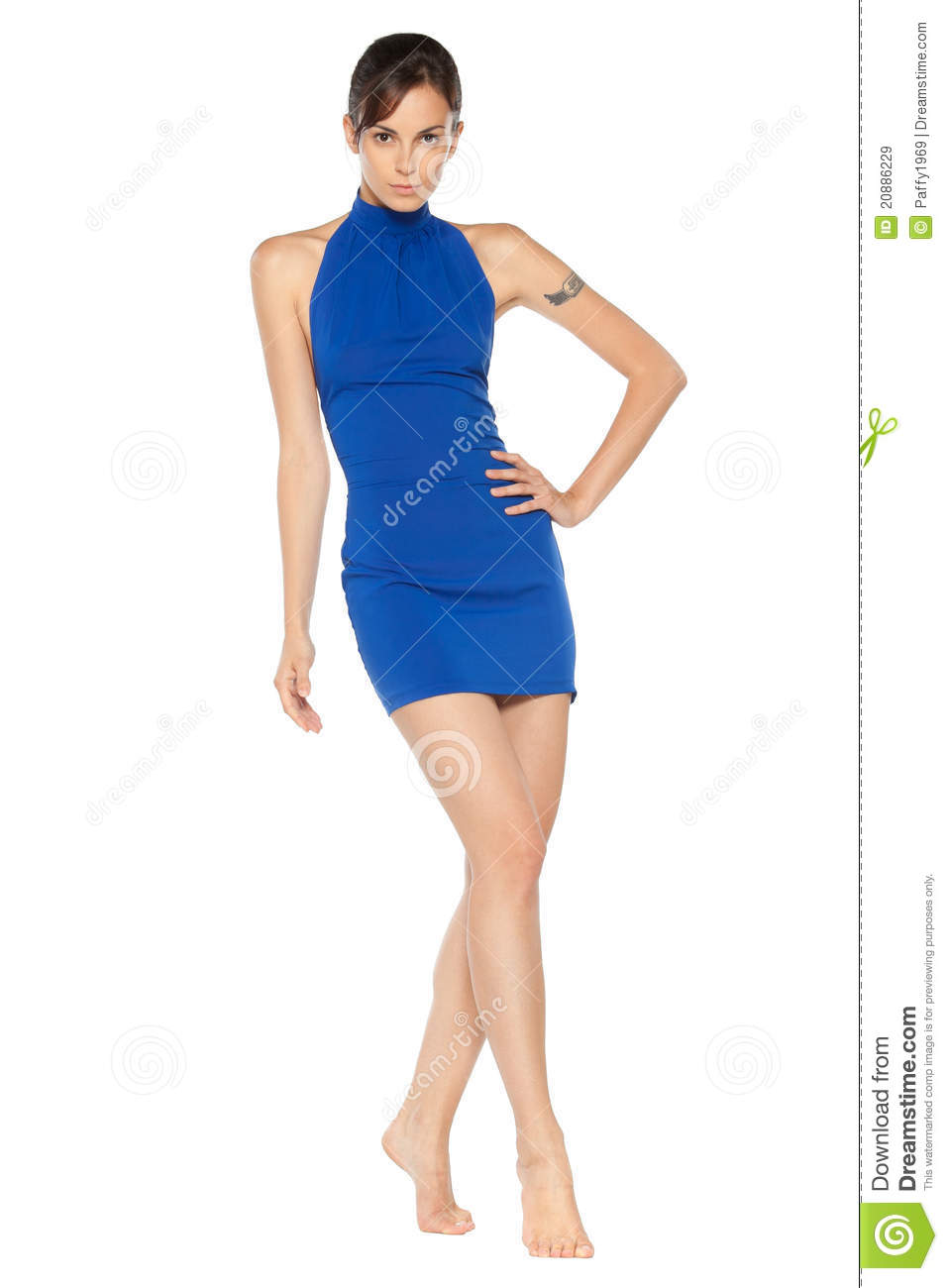 Female in blue dress posing