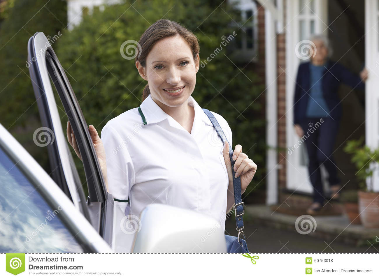 Female Care Worker Visiting Senior Woman At Home