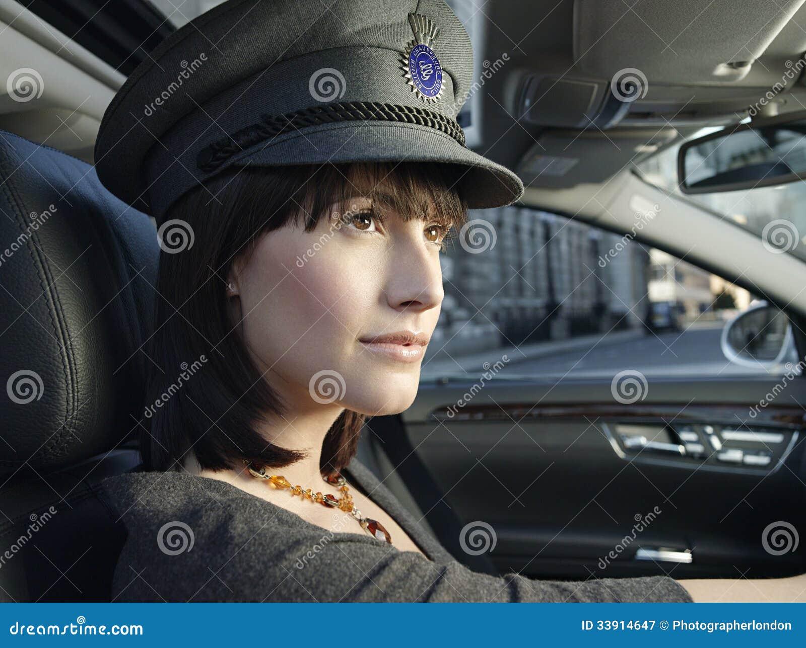Female Chauffeur Driving A Car Royalty Free Stock