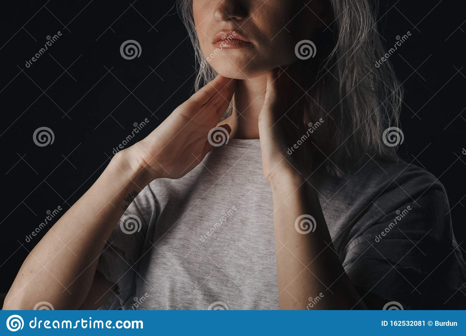 Female Checking Thyroid Gland By Herself Close Up Of Woman In