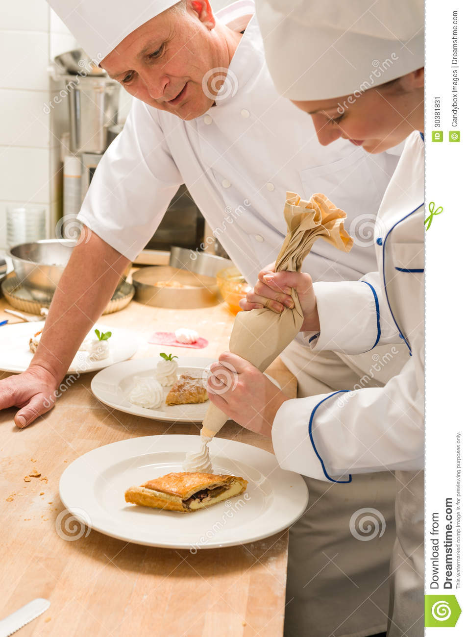 Cake Decorating Chefs : Female Chef Decorating Cake With Whipped Cream Stock Image ...