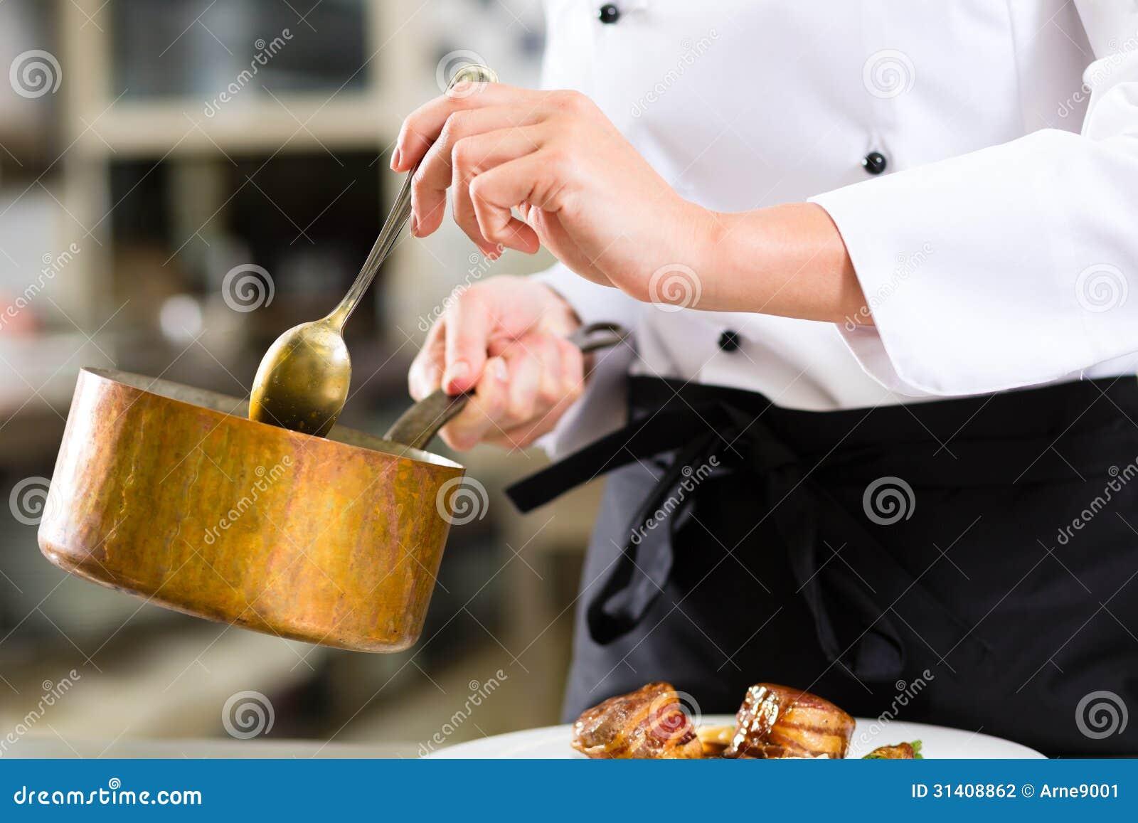 Restaurant Kitchen Photography female chef in restaurant kitchen cooking stock photography