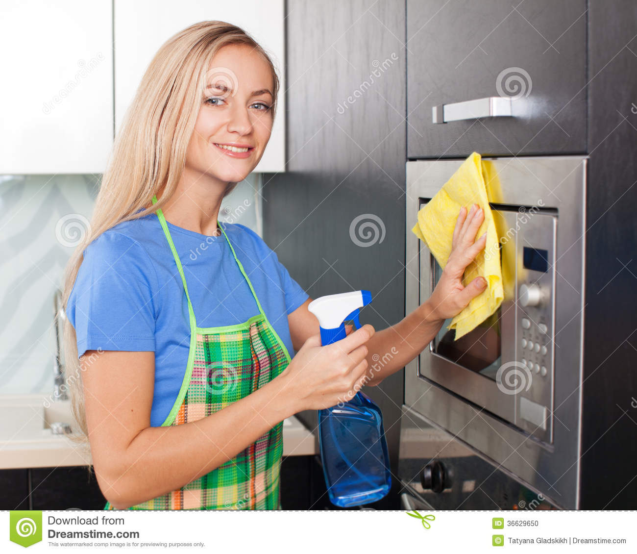 Female cleaning kitchen stock photo. Image of cleaner ...