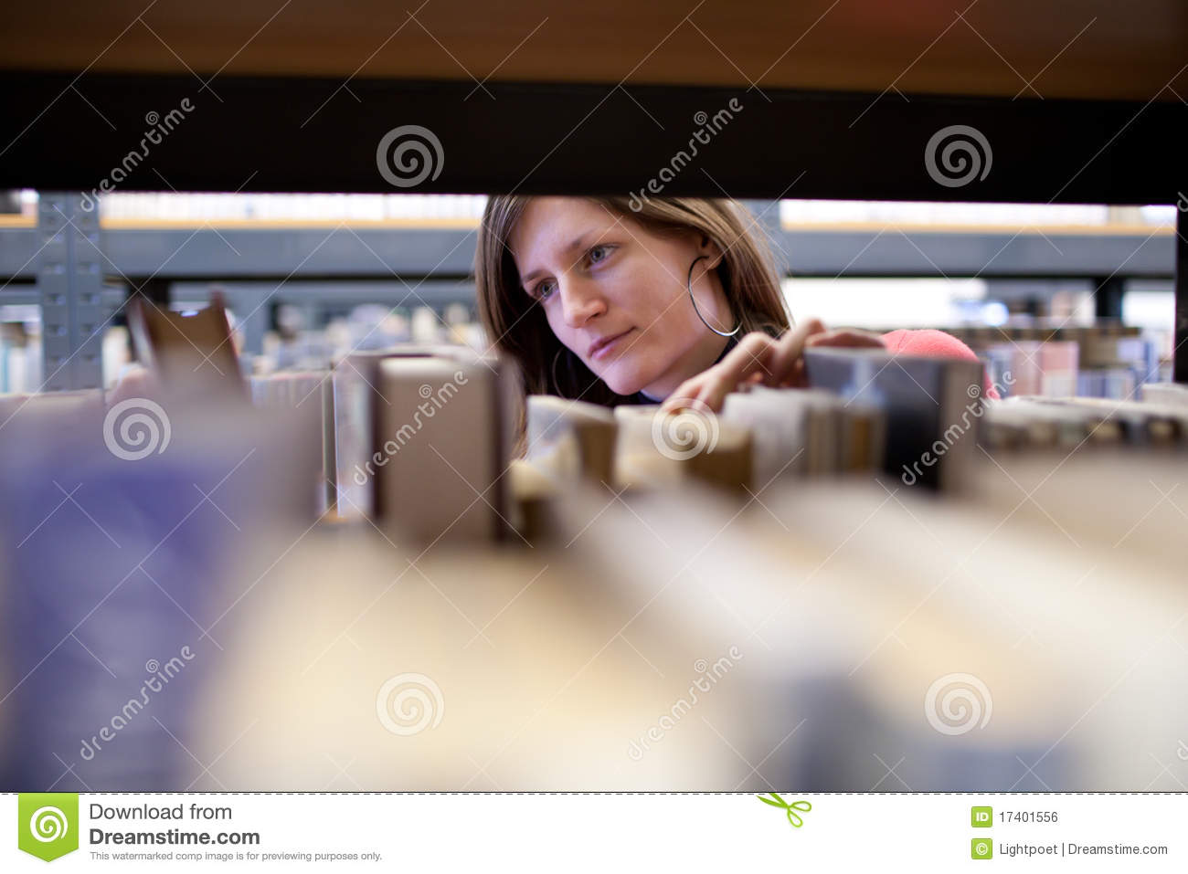 Female college student in a library
