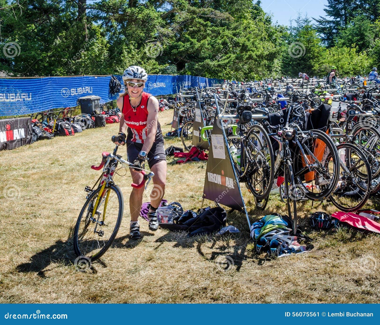 Female Competitor In Ironman Triathlon Race Editorial Photo