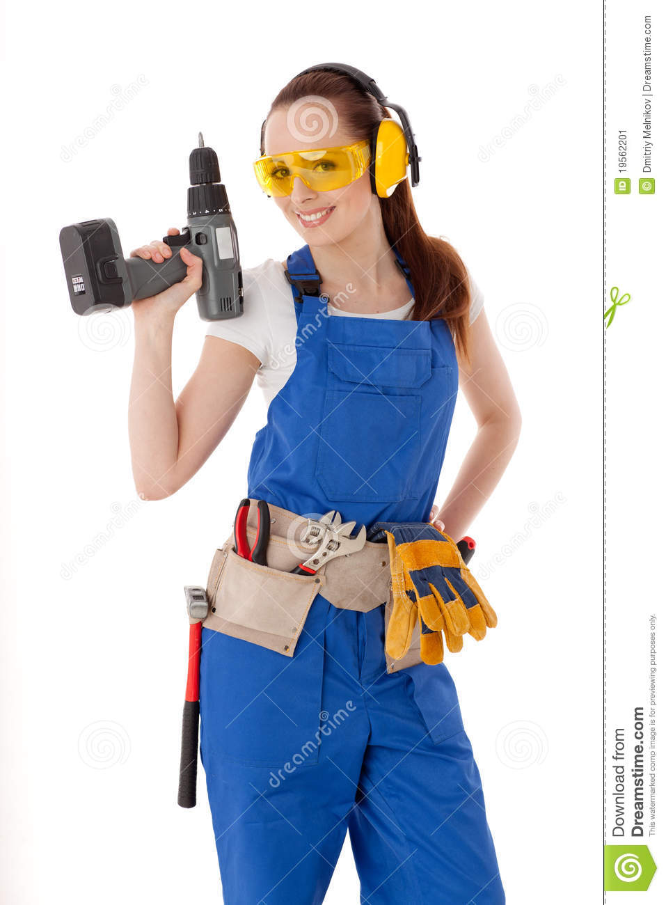 Young woman in coverall with screwdriver on a white background. Female ...