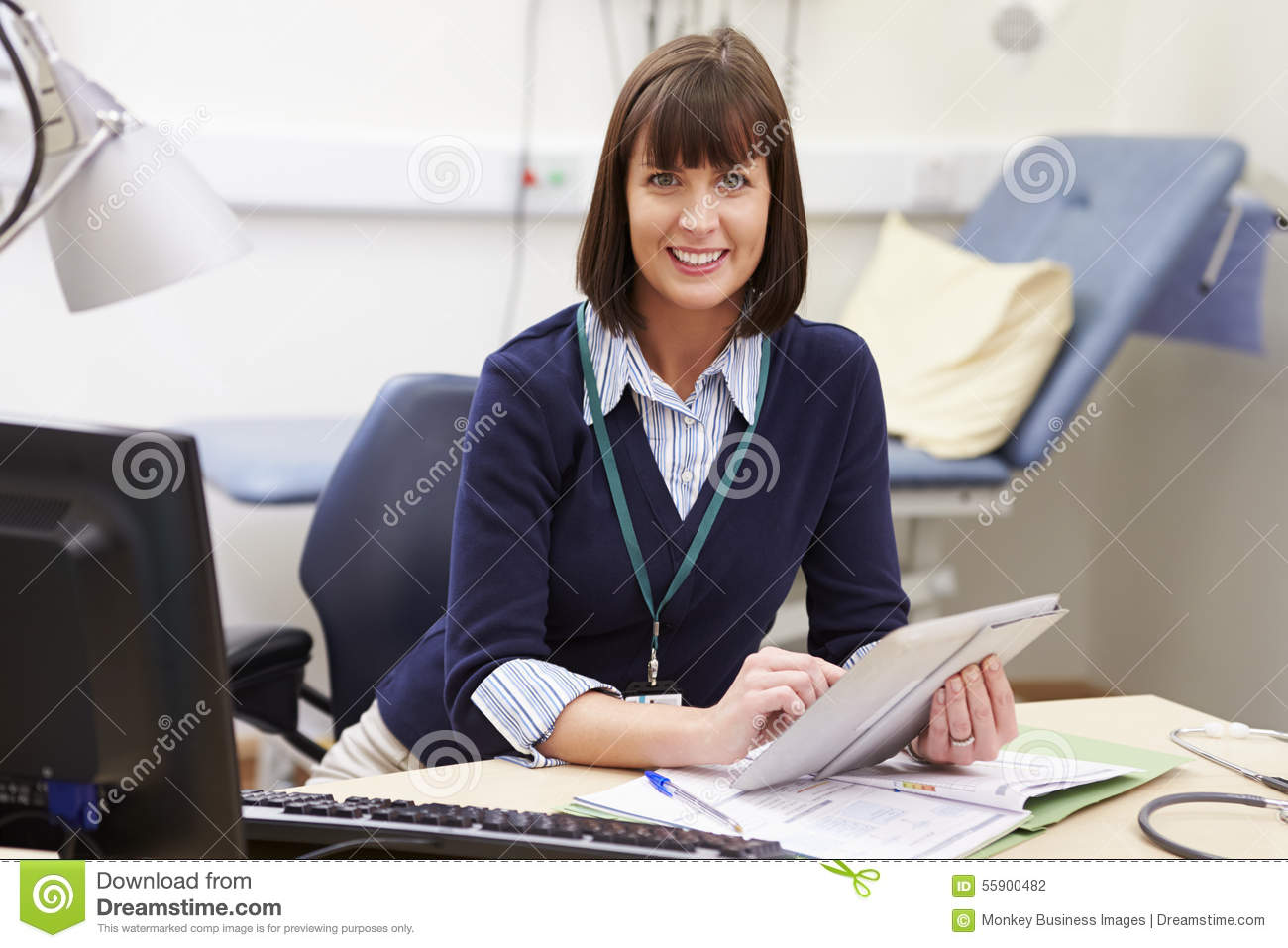 Female Consultant Using Digital Tablet At Desk In Office