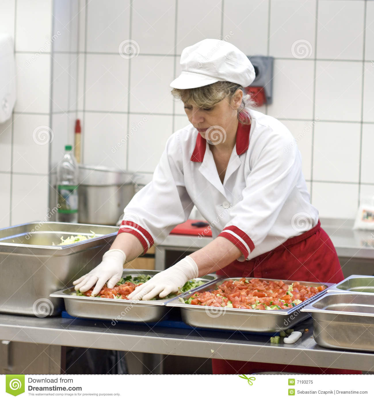 Female cook making salad