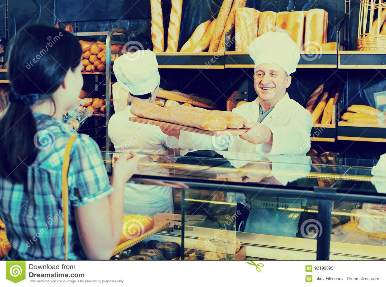 Female Customer Buying Bread In Bakery Stock Image - Image of people