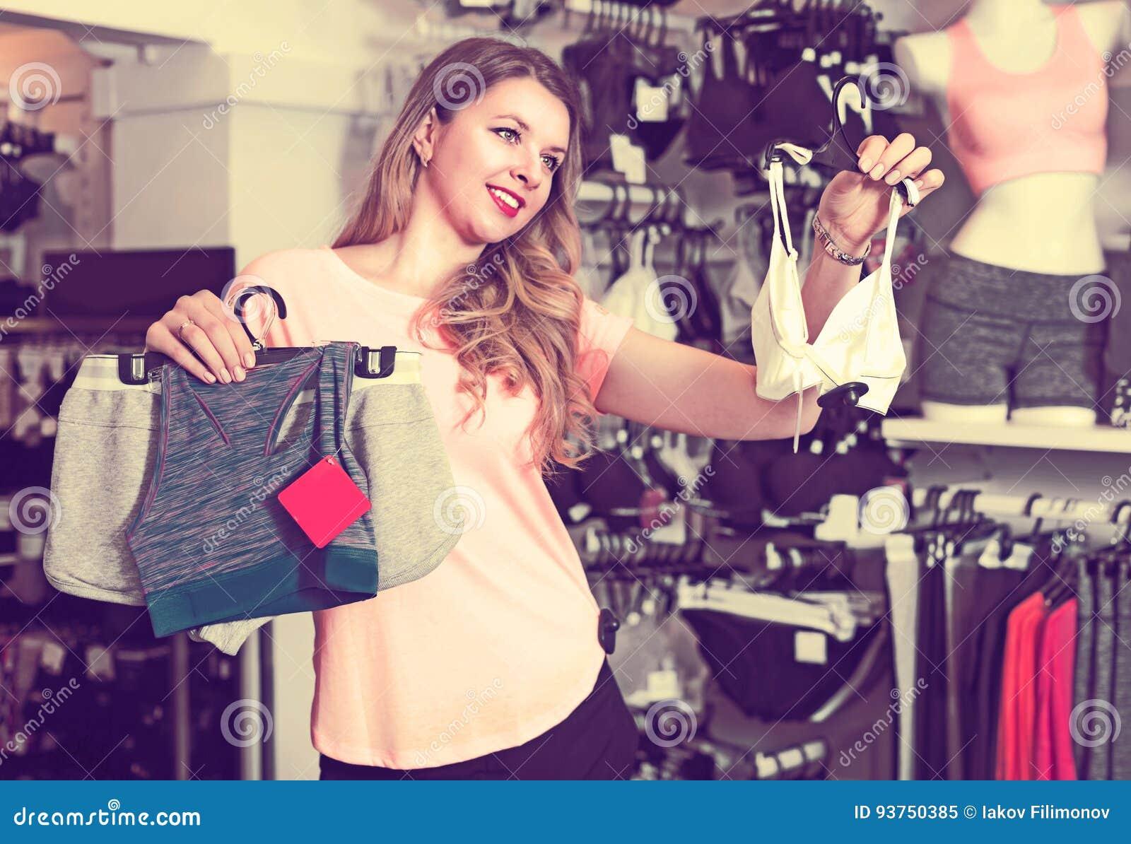 ce2634ae314 Female Customer Is Choosing Sports Underwear Stock Image - Image of ...