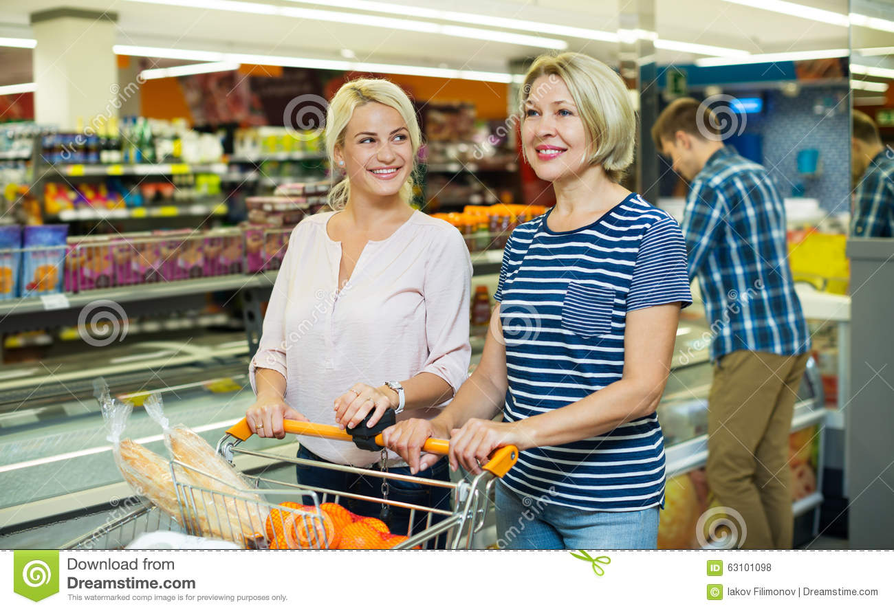 Female customers near display with frozen food