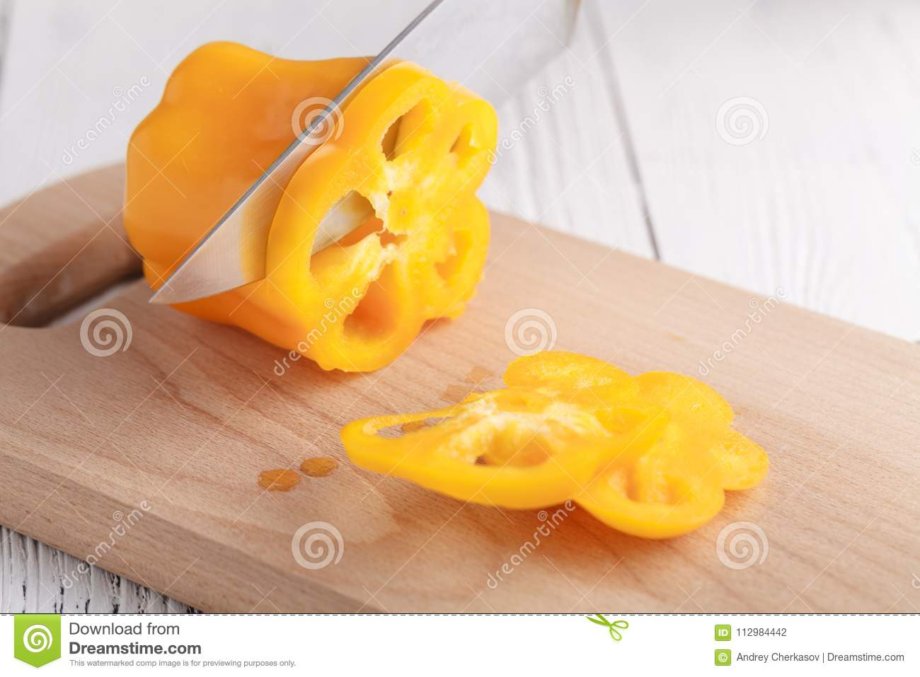Female cutting sweet bulgarian pepper