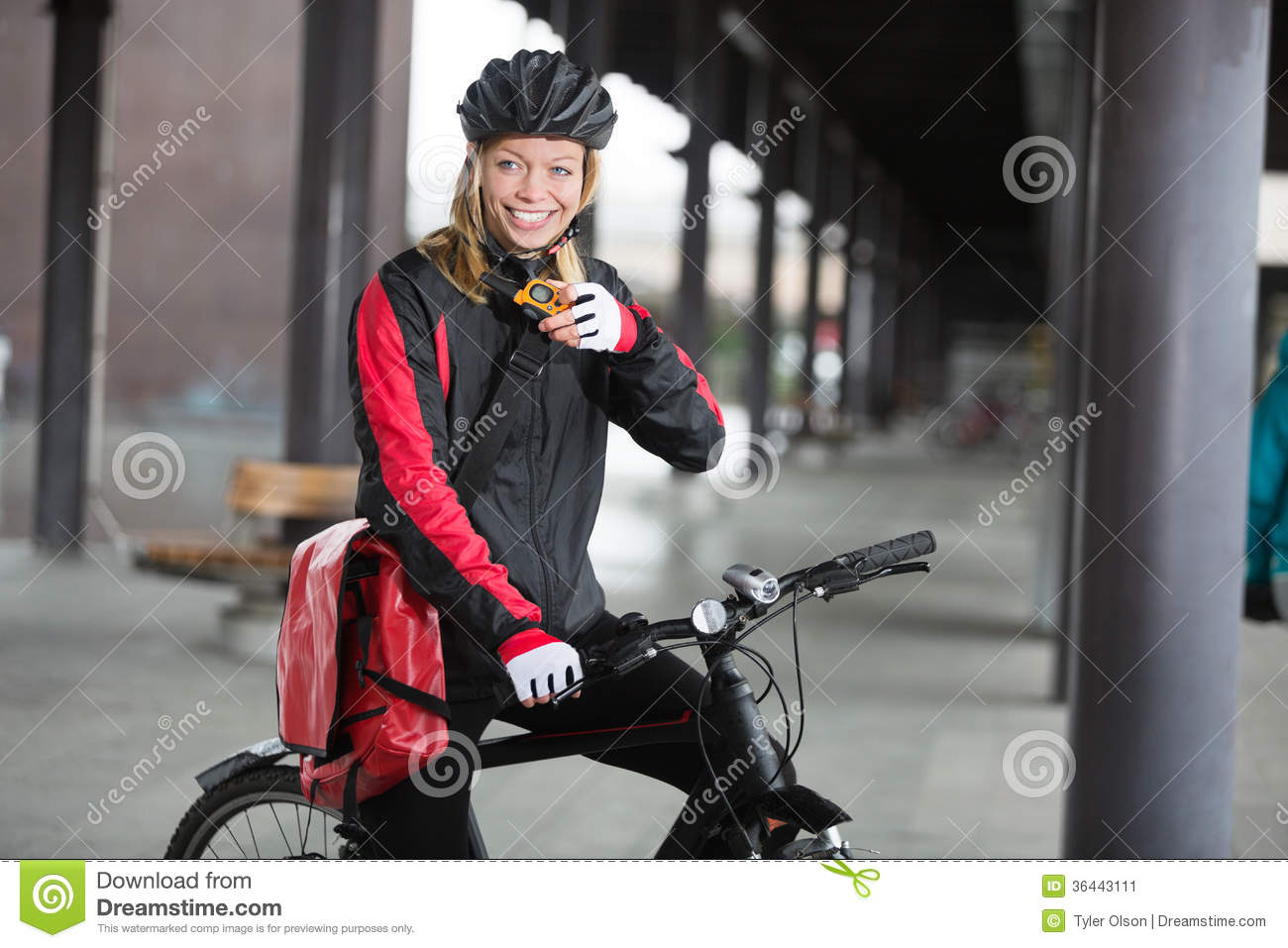 Female Cyclist With Courier Bag Using