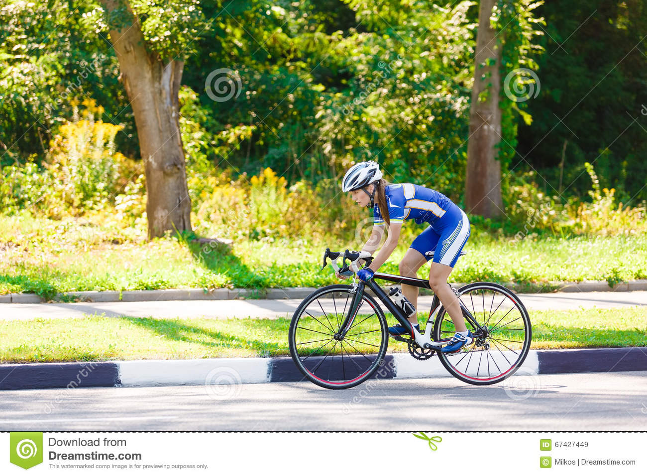 Female Cyclist Rides A Racing Bike On Road Stock Photo ...