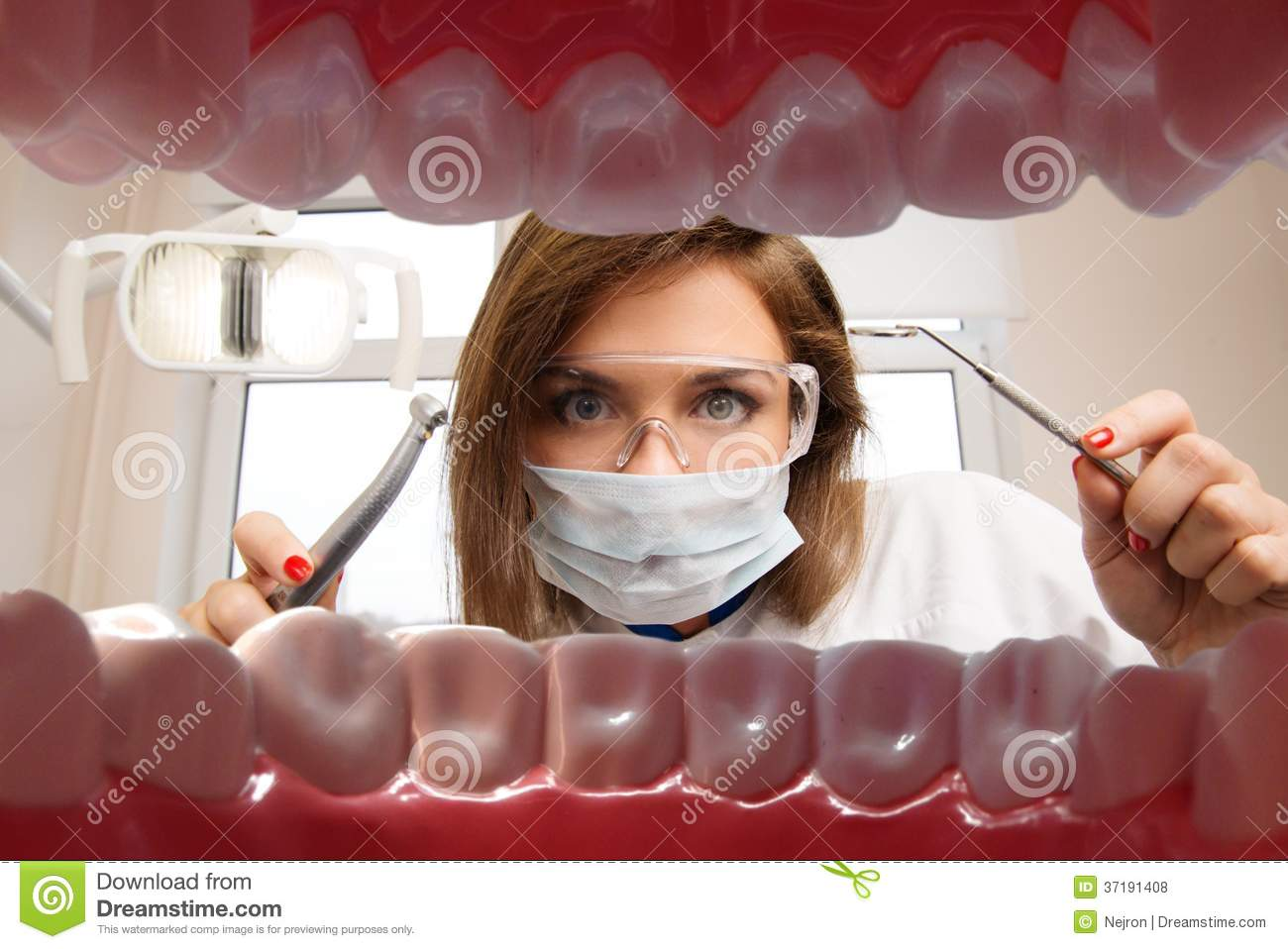 Female dentist with dental tools