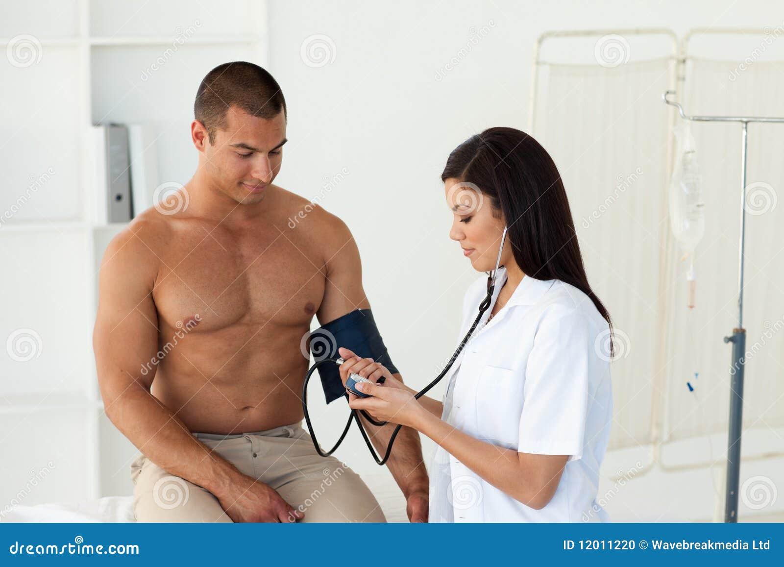 Doctor Checks Blood Pressure