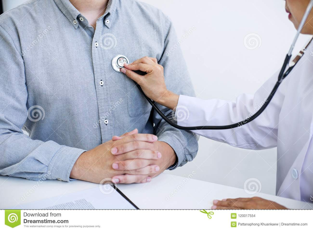 Female doctor checking heart beat of patient and recommend treat