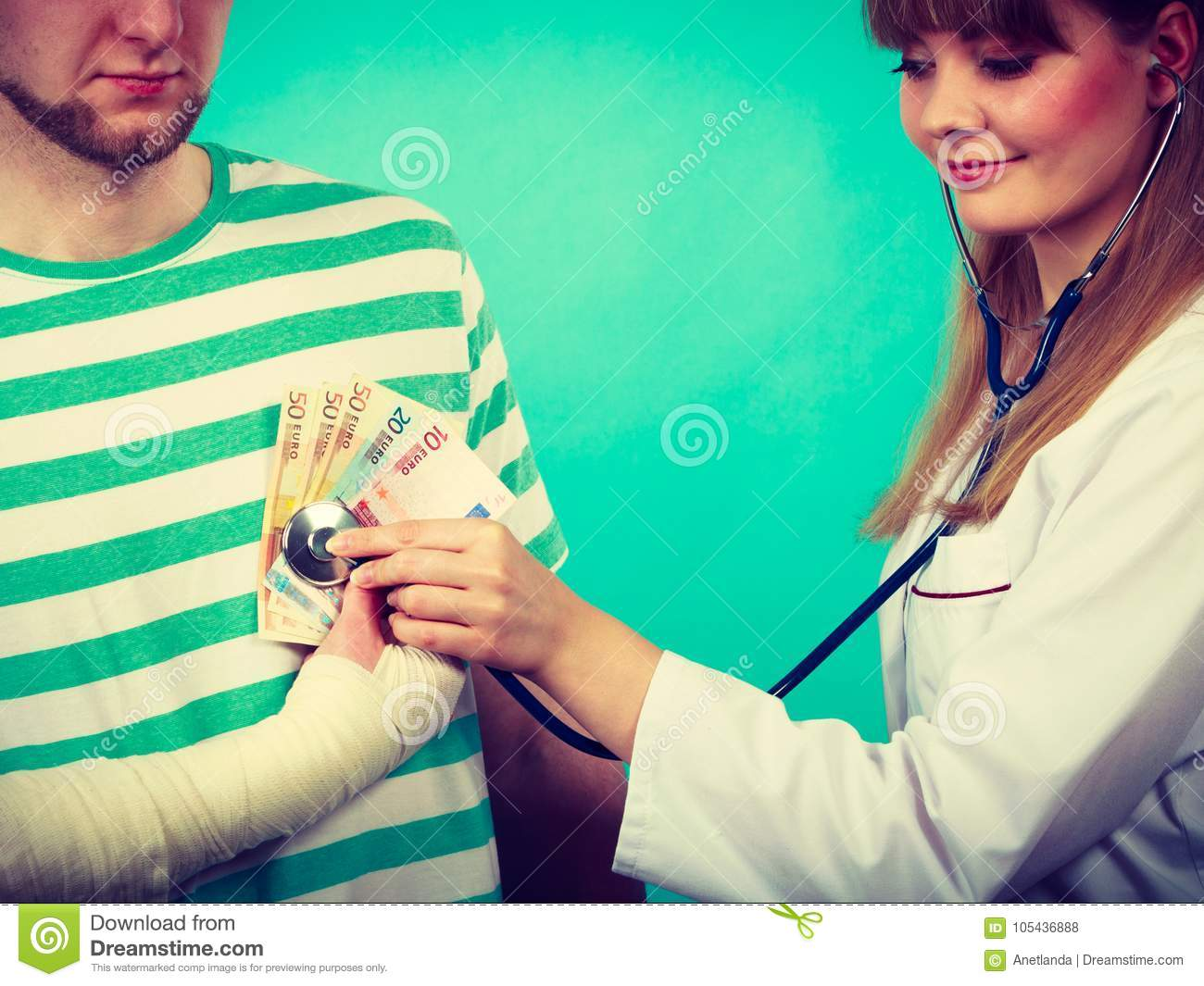 Female doctor checking heart beating.