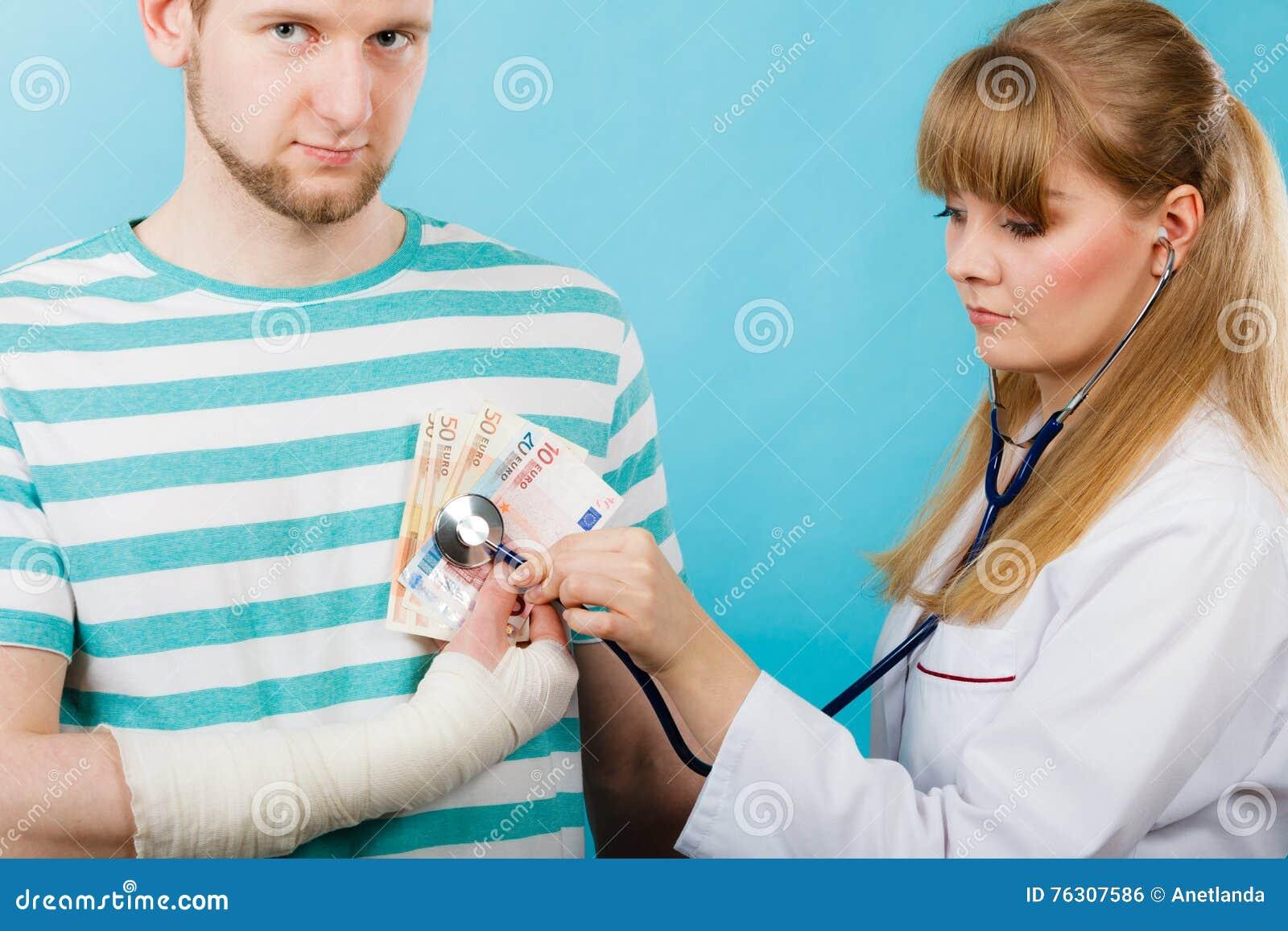 Female doctor checking heart beating.
