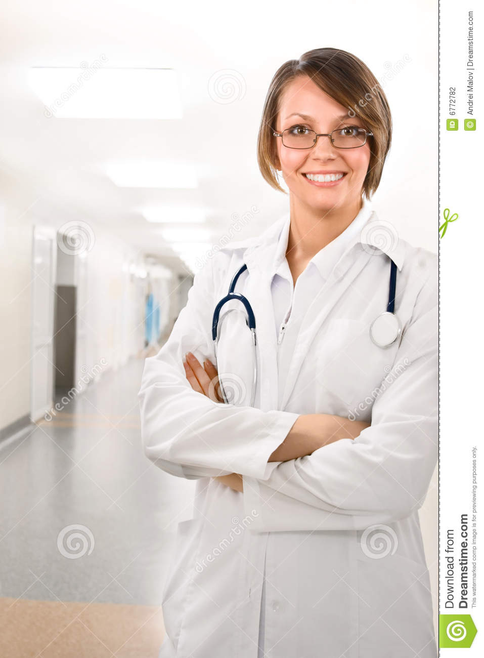 Female doctor in clinic under lamps