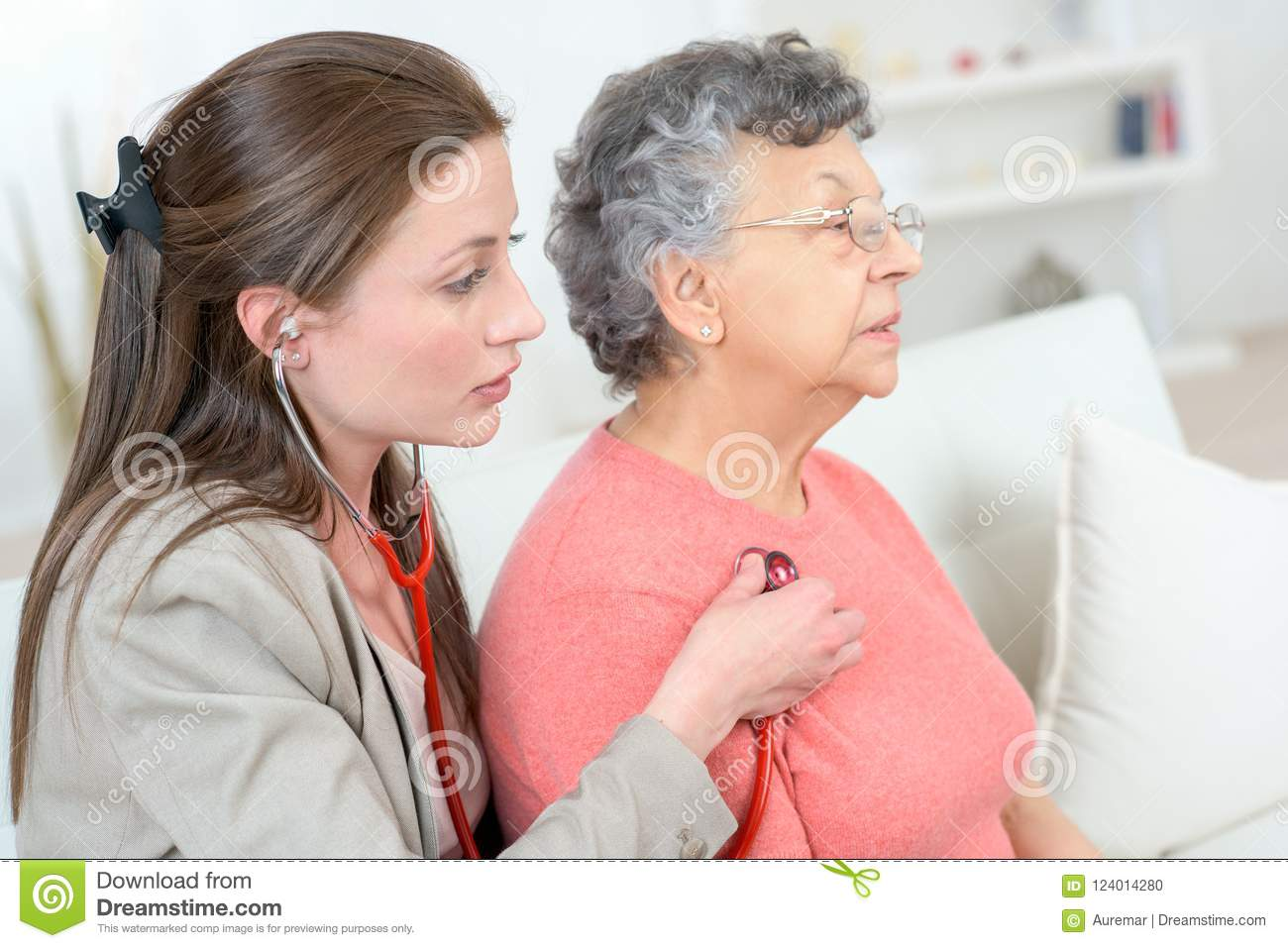Female doctor examine senior patient woman at home