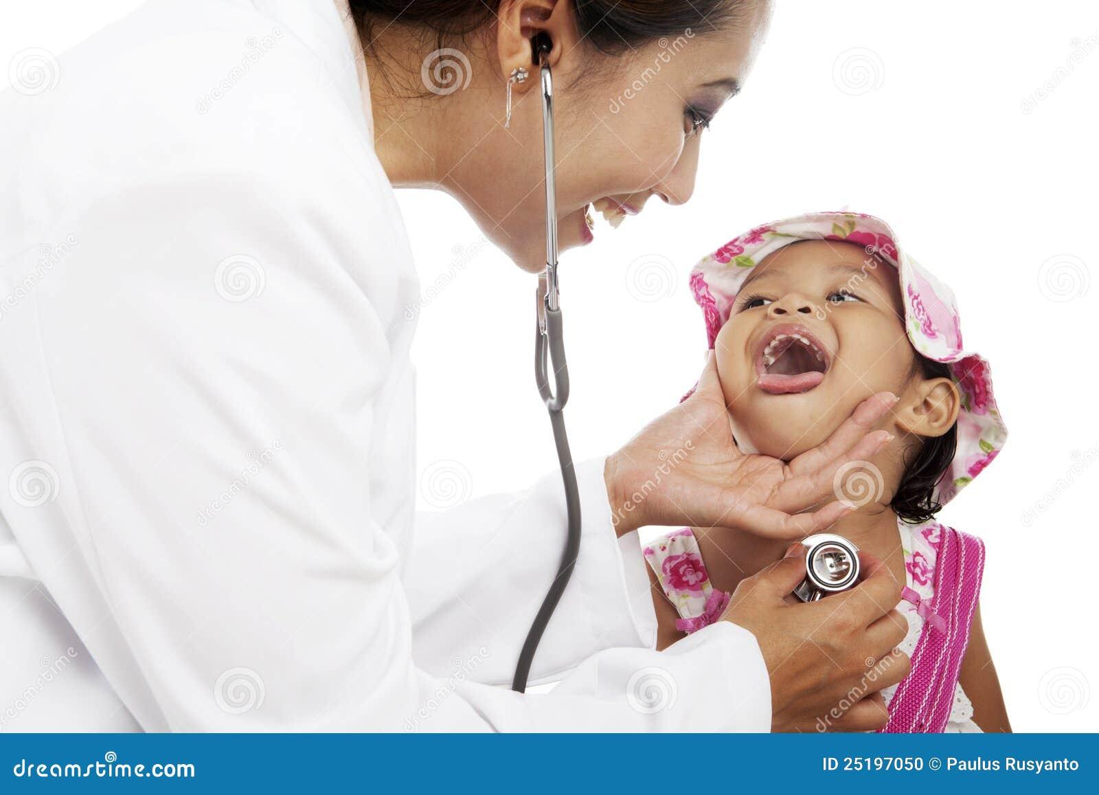 Female doctor examining little child boy — Stock Photo