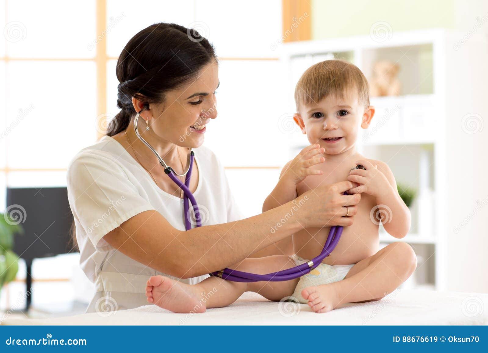 Female Doctor Examining Kid Little Child Stock Photo (Edit