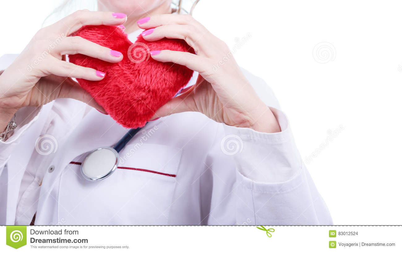 Female Doctor With Stethoscope Writing Diagnosis Stock