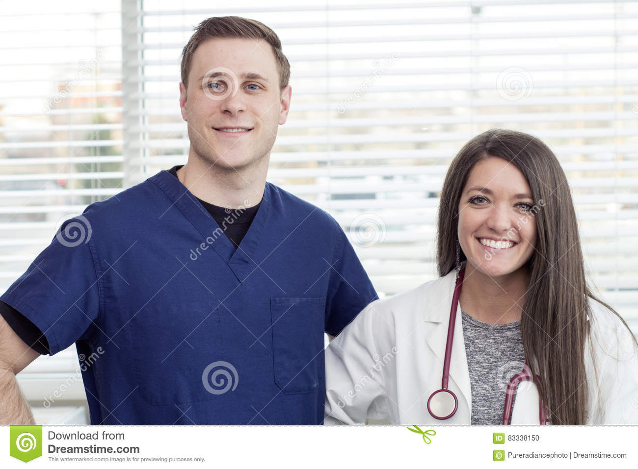 Female Doctor and male nurse smiling in office
