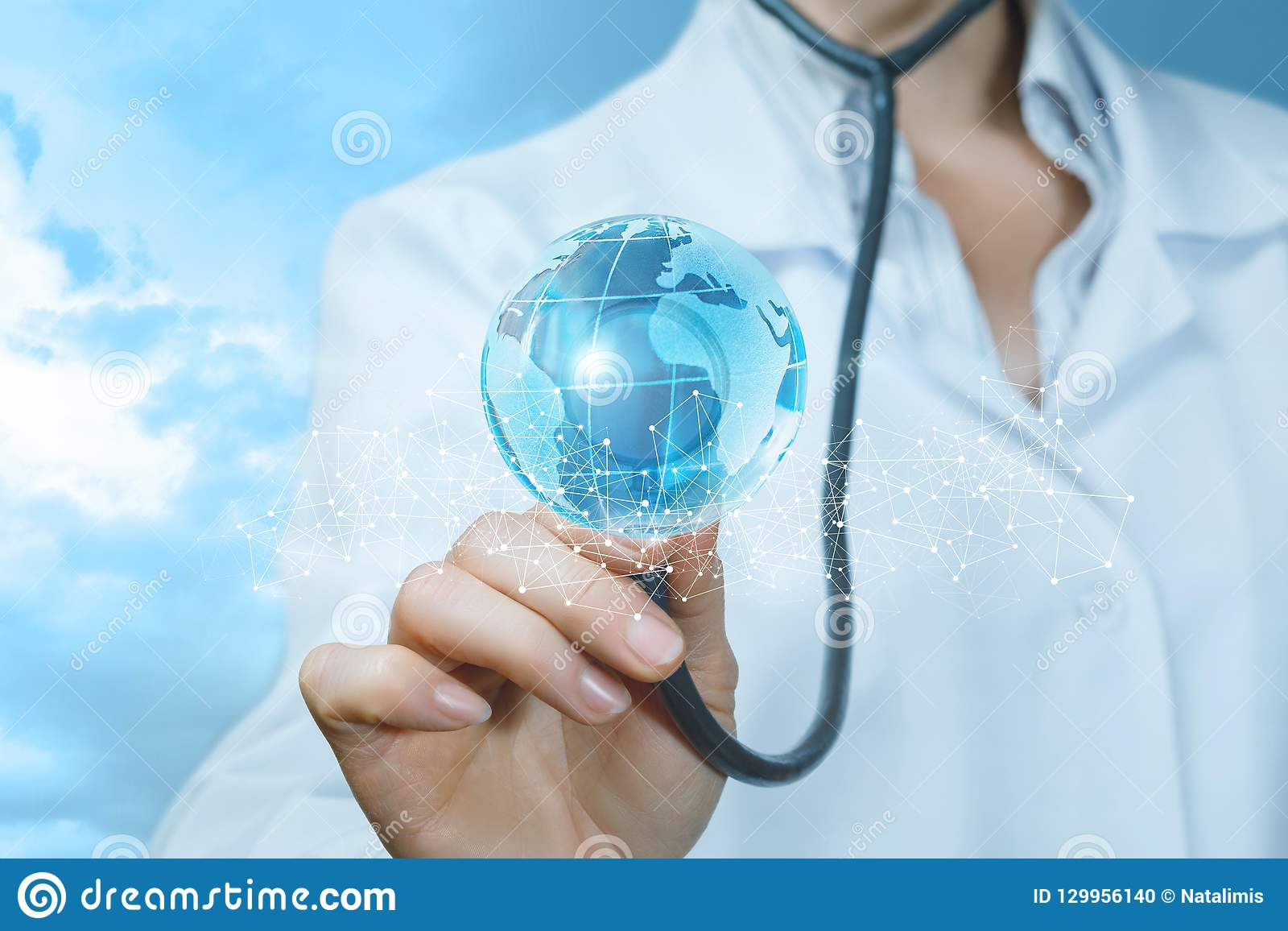 A doctor is touching a bright global map behind the fence of wireless connections with her stethoscope .