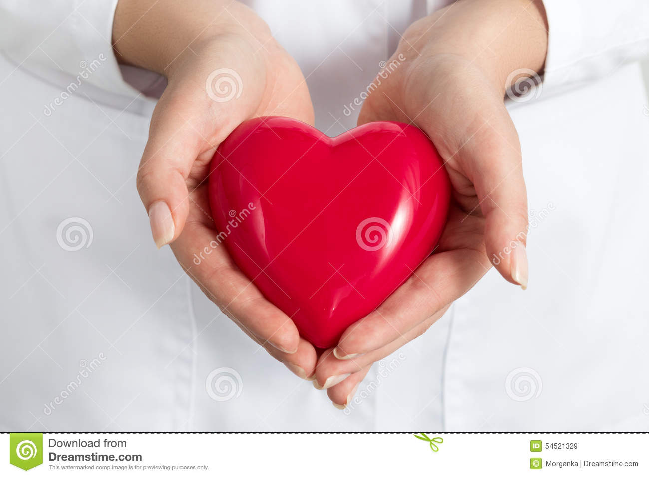 Female doctors s hands holding and covering red heart
