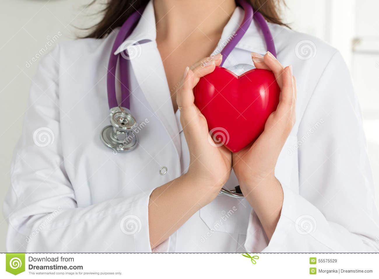 Female doctors s hands holding red heart